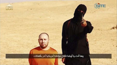 A masked, black-clad militant, who has been identified by the Washington Post newspaper as a Briton named Mohammed Emwazi, stands next to a man purported to be Steven Sotloff in this still image from a video obtained from SITE Intel Group website