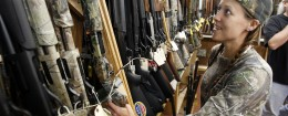 Shotguns in a Richmond, Va., gun store / AP