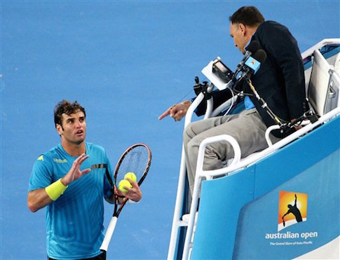 Tunisian Malek Jaziri argues with an umpire before losing a Australian Open match in straight sets / AP