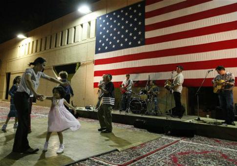 Dancers enjoying Cajun music in the garden of the U.S. ambassador's residence in Riyadh, Saudi Arabia in 2009. / AP