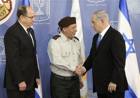 Israeli Prime Minister Benjamin Netanyahu, right, shakes hands with the new Israeli Chief of Staff Major Gen. Gadi Eisenkot, during a ceremony in Jerusalem Monday, Feb. 16, 2015. On the left is Israeli Defense Minister Moshe Yaalon