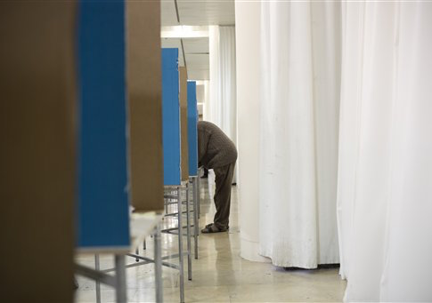 An Israeli Likud party member casts his vote during Likud party primary elections in Jerusalem, Wednesday, Dec. 31, 2014
