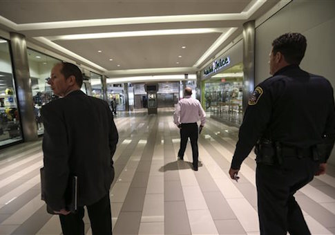 Mall of America security officials walked through the Mall of America on Monday, Feb. 23, 2015 in Bloomington, Minn.