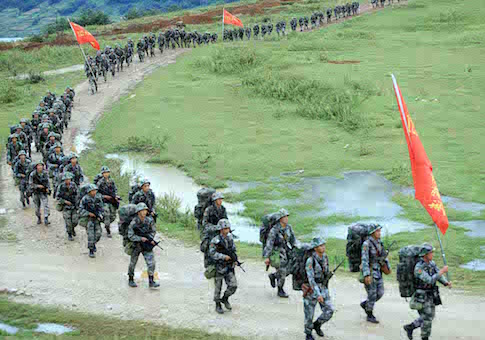 Chinese PLA (People's Liberation Army) soldiers march during a military drill in southwest China's Sichuan province, 23 September 2014