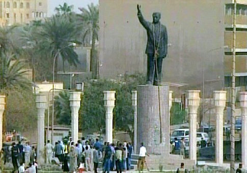 A rope hangs around the neck of a statue of Saddam Hussein, seen in this image from video, Wednesday, April 9, 2003, in Baghdad. Iraqis tied the rope onto the statue in an effort to pull it down