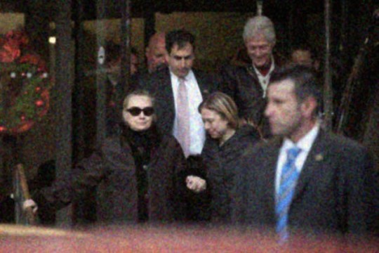 A woman believed to be Supreme Democratic Leader Hillary Clinton is spotted leaving a hospital with her family. (State News Agency)