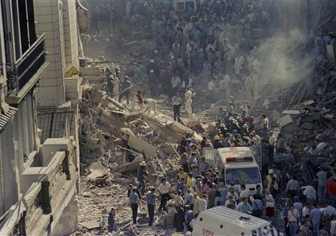 In this March 17, 1992 file photo, firemen and rescue workers walk through the debris of Israel's Embassy after a terrorist attack in Buenos Aires, Argentina