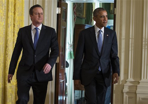 President Barack Obama and British Prime Minister David Cameron arrive for their joint news conference in the East Room of the White House in Washington, Friday, Jan. 16, 2015