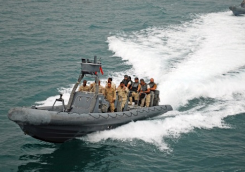 "A Kuwait Navy rigid-hulled inflatable boat speeds toward U.S. Army Vessel ""Corinth"" as part of a visit, board, search and seizure scenario during Exercise Eagle Resolve March 17, 2015"