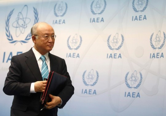 IAEA Director General Amano leaves a news conference after a board of governors meeting at the IAEA headquarters in Vienna