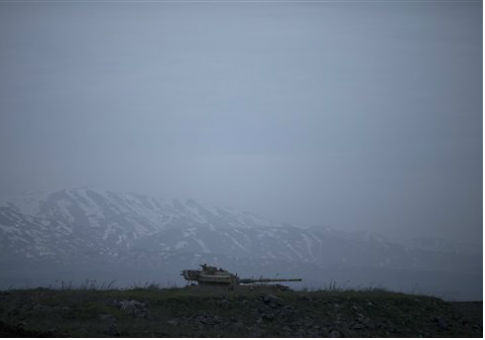 An old Israeli tank sits in the Golan Heights near the border with Syria. / AP