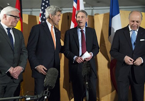 From left, German Foreign Minister Frank Walter Steinmeier, U.S. Secretary of State John Kerry, British Foreign Secretary Philip Hammond and French Foreign Minister Laurent Fabius talk after Hammond made a statement about their meeting regarding recent negotiations with Iran over Iran's nuclear program in London, England, Saturday, March 21
