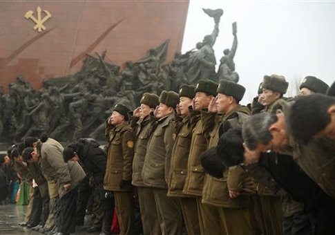 N. Korean soldiers salute before late leaders' statutes