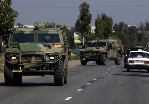 Russian army's armoured vehicles are seen on a road in Kamensk-Shakhtinsky, Rostov region, near the border with Ukraine, August 23, 2014