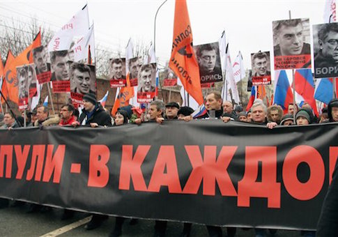 People hold pictures of Boris Nemtsov