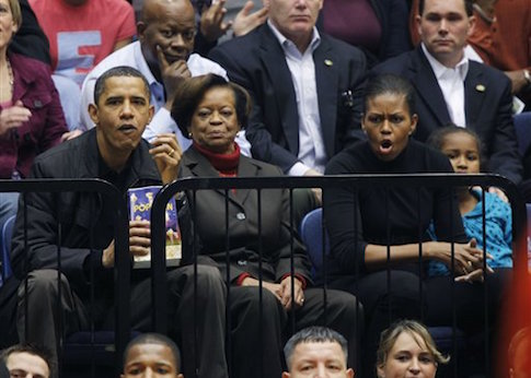 Barack and Michelle Obama at an Oregon State basketball game in Craig Robinson's first year as head coach in 2009 / AP