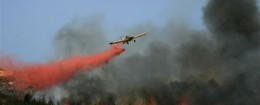 An Israeli plane attempts to extinguish a fire caused by a Hezbollah rocket. / AP