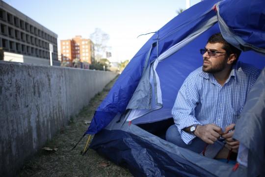 Freed Guantanamo Bay detainee Omar Abdelahdi Faraj sits outside the U.S. embassy in Montevideo. / AP