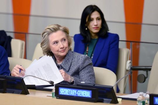 Huma Abedin sits close behind Hillary Clinton / AP