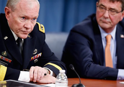 Joint Chiefs of Staff Gen. Martin Dempsey, left, accompanied by Secretary of Defense Ash Carter, right, speaks during a news conference at the Pentagon, Thursday, April 16