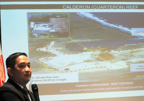 Francisco Acedillo, a lawmaker and a former air force pilot, shows a slide of China's reclamation work in the Spratly as he called for a creative strategy to deal with the maritime territorial dispute during a Foreign Correspondent of the Philippines (FOCAP) meeting in Manila March 26, 2015