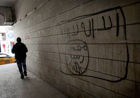 Graffiti depicting the flag of the Islamic State / AP