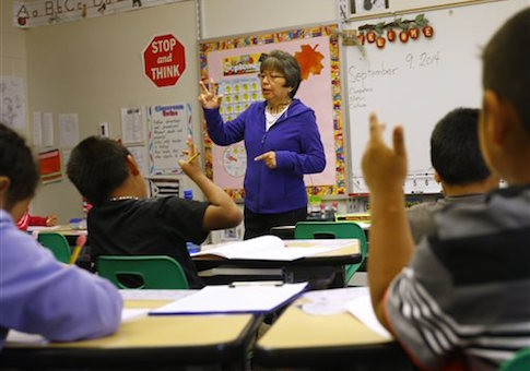 In this Sept. 9, 2014, photo, Joan Willow leads her classroom at Arapahoe Elementary School in Arapahoe, Wyo. on the Wind River Indian Reservation