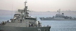 In this picture taken on Tuesday, April 7, 2015, and released by the semi-official Fars News Agency, Iranian warship Alborz, foreground, prepares before leaving Iran's waters