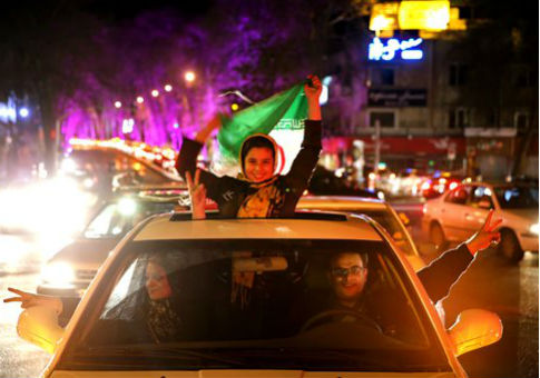 Iranians in northern Tehran celebrate the announcement of a nuclear agreement with Western powers. / AP