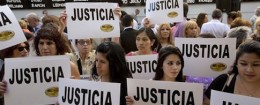 "People gather outside the AMIA Jewish community center asking for ""Justice"" in the death of a prosecutor who had accused Argentinaís president of a criminal conspiracy, in Buenos Aires, Argentina, Wednesday, Jan. 21"