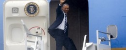 President Barack Obama waves as he enters Air Force One