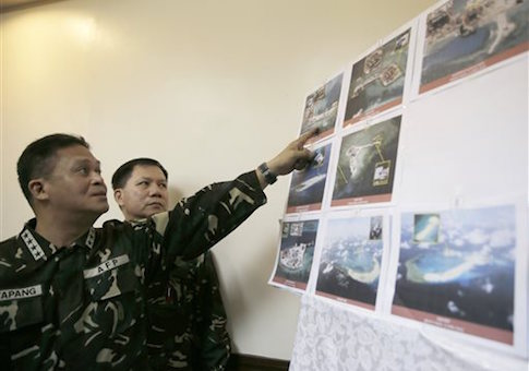 Armed forces of the Philippines Chief of Staff Gen. Gregorio Pio Catapang points to reveal recent images of China's reclamation activities being done at the disputed islands in the South China Sea during a news conference Monday, April 20