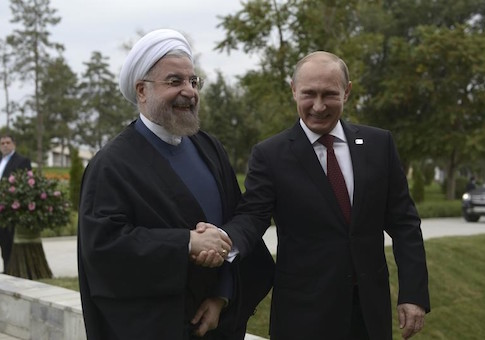 Russia's President Putin shakes hands with his Iranian counterpart Rouhani at the welcoming ceremony during a summit of Caspian Sea regional leaders in the southern city of Astrakhan