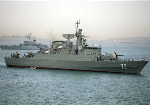 A warship prepares to leave Iranian waters / AP