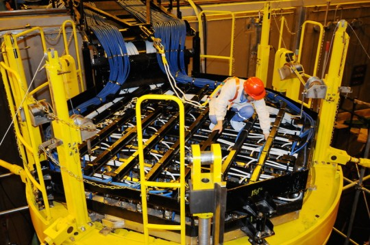 A Chinese technician lays cables on a nuclear reactor built with the technologies of Hualong-1 reactor at Fangchenggang Nuclear Power Plant / AP