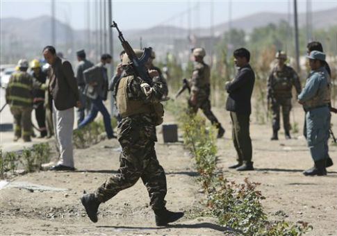 Afghan security forces at the site of an explosion in Kabul /  AP