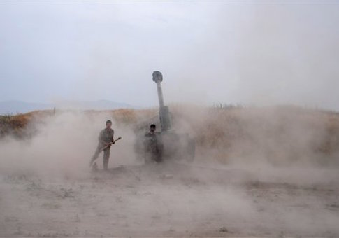 Afghan National Army soldiers fire artillery during a battle with Taliban insurgents in the Chahardara district of Kunduz province northern of Kabul, Afghanistan, Sunday, May 3