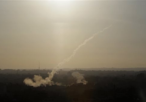 In this Aug. 9, 2014 file photo, a rocket is fired from Gaza City towards Israel