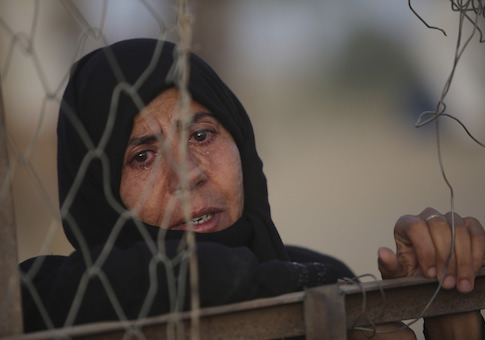 An Iraqi Sunni displaced woman, who fled the violence in the city of Ramadi, is seen at the outskirts of Baghdad