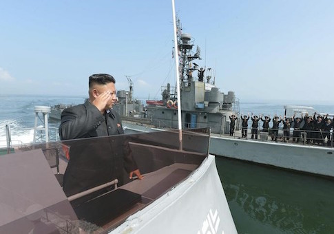 North Korean leader Kim salutes during a landing drill of the Army Ground, Naval, Air and Anti-Air forces of the KPA