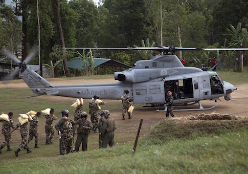 Nepalese service members load relief supplies into a U.S. Marine Corps UH-1Y Venom from Joint Task Force 505 at Sindhuli, Nepal in this May 11
