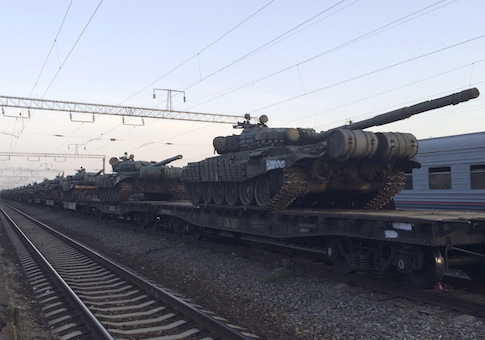Tanks are seen on a freight train shortly after its arrival at a railway station in the Russian southern town of Matveev Kurgan