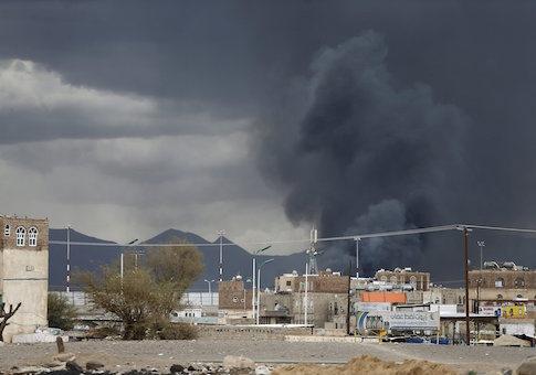 Smoke billows after an air strike hit the international airport of Yemen's capital Sanaa