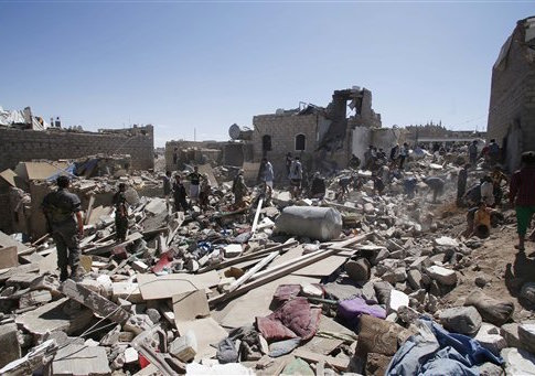 People search for survivors under the rubble of houses destroyed by Saudi-led airstrikes in Sanaa, Yemen