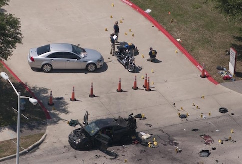 An aerial view shows the area around a car that was used the previous night by two gunmen, who were killed by police, as it is investigated by local police and the FBI