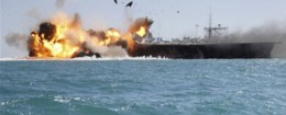 Footage of a mocked-up version of a U.S. aircraft carrier being destroyed by an Iranian warship / AP