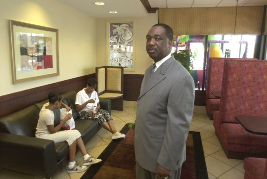 McDonald's franchise owner Errol Service stands in his restaurant in Harper Woods, Mich. / AP