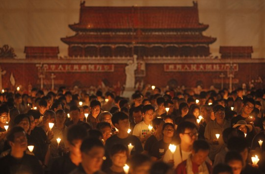 Tens of thousands of Hong Kongers joined the candlelight vigil Thursday night marking the crushing of the 1989 student-led Tiananmen Square protests. / AP