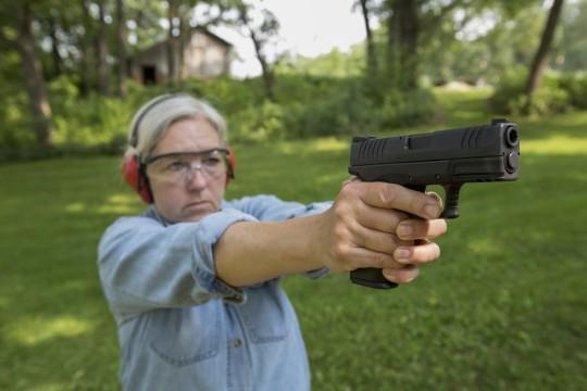 Woman with gun / AP