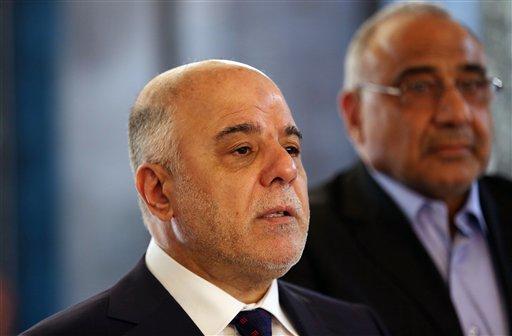 Iraqi Prime Minister Haider al-Abadi, left / AP